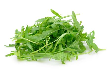 ruccola: Pile of ruccola leaves in isolated white background Stock Photo