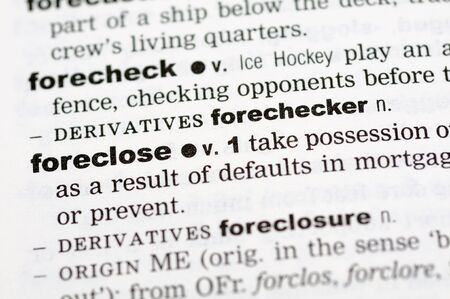 foreclose: A close up of the word foreclose from a dictionary
