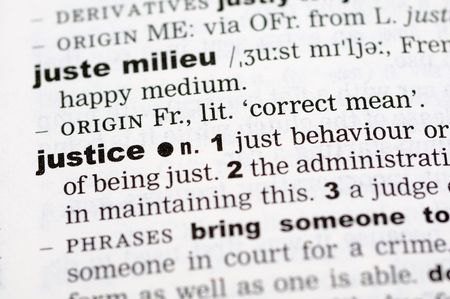 definitions: A close up of the word justice from a dictionary Stock Photo