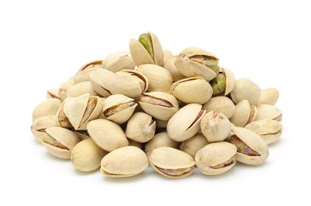 Heap of pistachios nuts in isolated white background