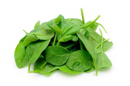 Baby spinach leaves in isolated white background photo