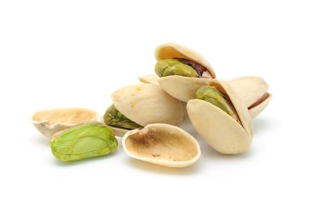 Heap of pistachios nuts in isolated white background photo