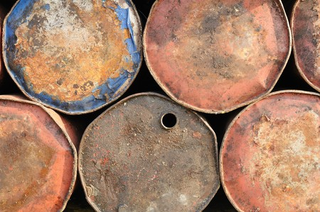 Background of old rusty drums for industrial use Stock Photo