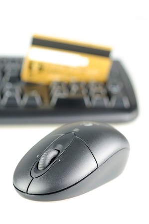 Online purchase concept - wireless mouse, keyboard and credit card photo