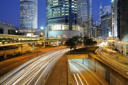 Busy traffic in Hong Kong Central district at night photo