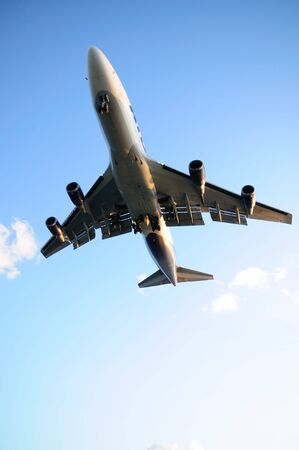 Big passenger airplane overhead in blue sky Stock Photo - 5377036