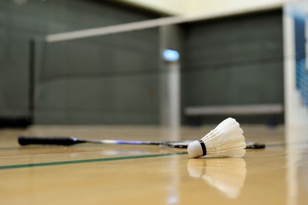 shuttlecock: Close up of shuttlecock and racket in badminton game