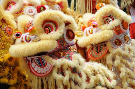 Chinese dancing lion head in golden color photo
