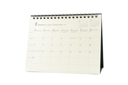 Multilingual desktop calendar February 2011 in isolated white background photo