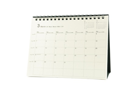 Multilingual desktop calendar March 2011 in isolated white background photo