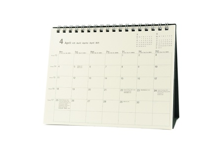 Multilingual desktop calendar April 2011 in isolated white background photo