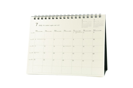 Multilingual desktop calendar July 2011 in isolated white background photo