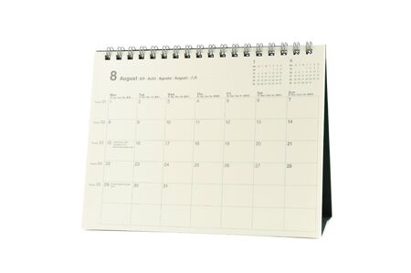 Multilingual desktop calendar August 2011 in isolated white background photo