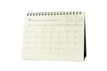 Multilingual desktop calendar September 2011 in isolated white background photo