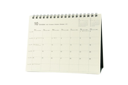 Multilingual desktop calendar october 2011 in isolated white background photo