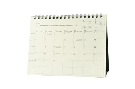 Multilingual desktop calendar november 2011 in isolated white background photo