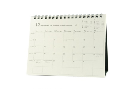 Multilingual desktop calendar December 2011 in isolated white background photo