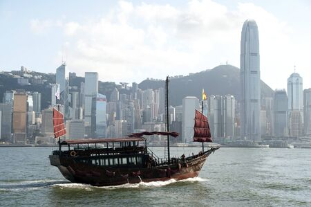 Chinese sailing ship and Hong Kong skyline