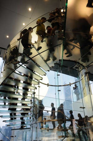 People using the glass stair in Hong Kong Apple store