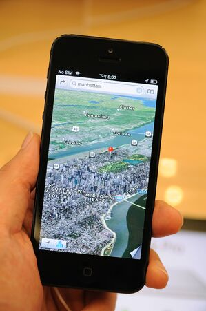 Close up of black iPhone 5 displaying the new map 3D views  Stock Photo - 15370364