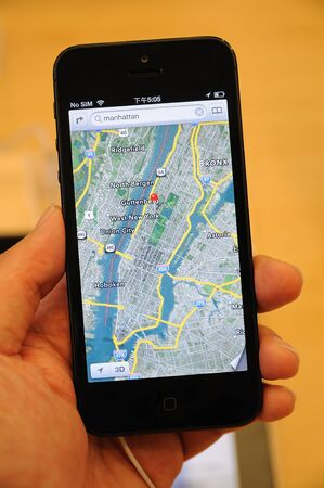 Close up of black iPhone 5 displaying the new IOS6 map Stock Photo - 15370365