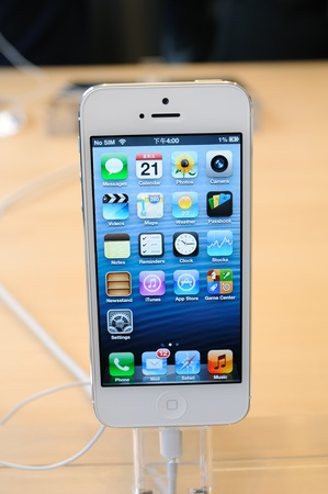 Close up of white iPhone 5 display in Hong Kong Apple store Stock Photo - 16093753