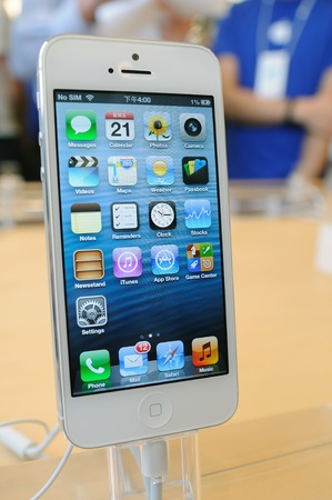 iphone5: Close up of white iPhone 5 display in Hong Kong Apple store Editorial