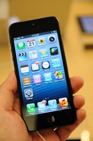 Close up of black iPhone 5 display in Hong Kong Apple store