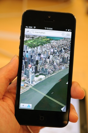iphone5: Close up of black iPhone 5 displaying the new map 3D views  Editorial