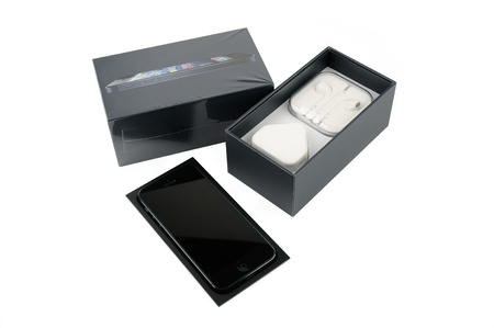 iphone5: iPhone 5 with packaging, isolated in white backgorund
