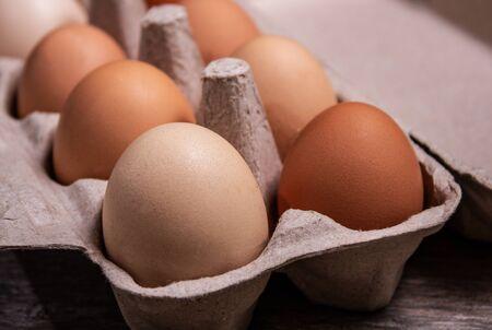 fresh eggs in a grey carton box