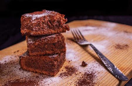 homemade chocolate brownie with sugarpowder and cocoa powder