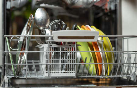 An open dishwasher with dirty dishes in it. Dishwasher in a kitchen. Stock fotó
