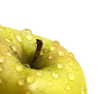 Apple with waterdrops on its surface photo
