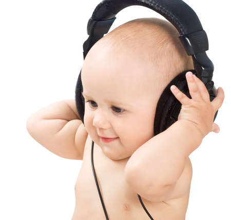 Smiling baby with headphone photo