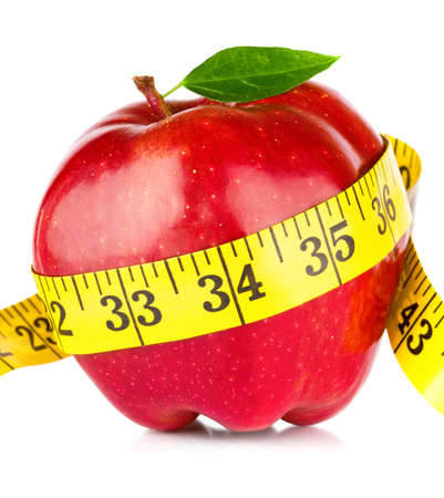 Red apple with measure tape on white background  Stock Photo