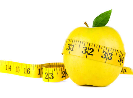 produce energy: Yellow apple surrounded by measuring tape