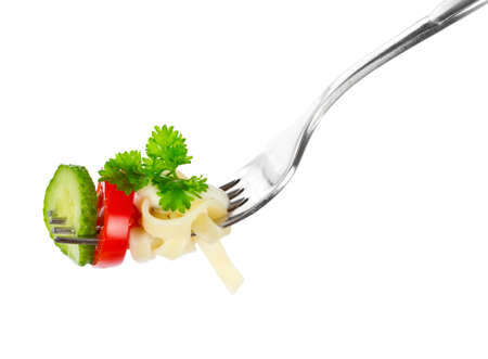 Pasta on a fork over white background  photo