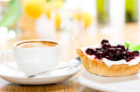 cakes and pastries: Fruit dessert and coffee