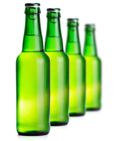 luxuriate: Green beer bottles on the white background Stock Photo