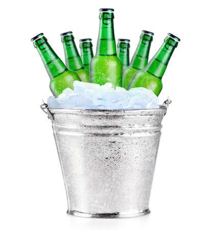 Green beer bottles in ice photo