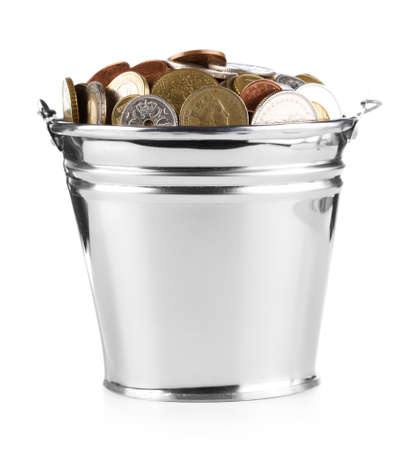 dividends: bucket full of coins over white Stock Photo