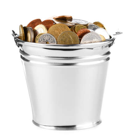 bucket full of coins over white photo