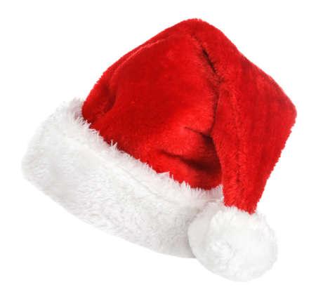 白い背景で隔離赤いサンタ帽子 写真素材