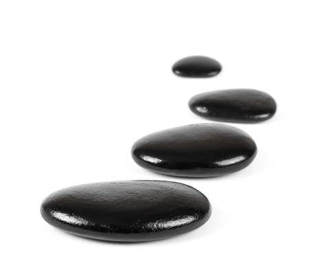 gradual: Piedras negras sobre fondo blanco Foto de archivo