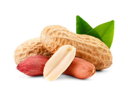 hard core: Peanuts and shell  with green leaf. Isolated on a white background.