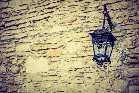 castle wall: Old lantern on the castle wall