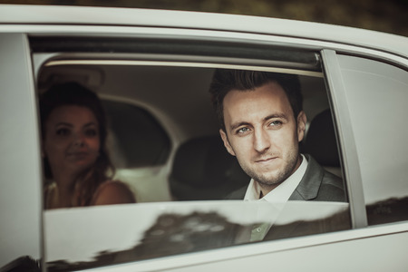 limousine: Wedding photo, groom and bride in the car