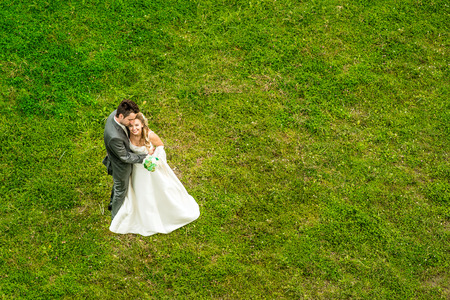 Wedding couple outdoor with green grass on background