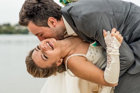 couples hug: Wedding couple outdoor with lake on background